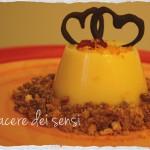 Budino all'arancia con crumble di amaretti e marron glacè